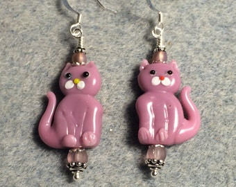 Opaque mauve pink lampwork cat bead dangle earrings adorned with pink Czech glass beads.