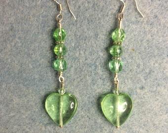 Light green Czech glass heart bead dangle earrings adorned with light green Czech glass beads.