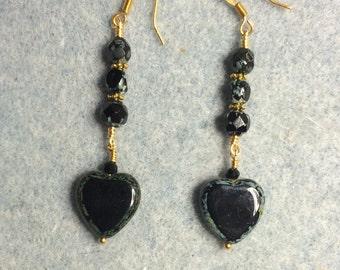 Black Czech glass heart dangle earrings adorned with black Czech glass beads.