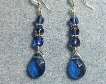 Capri blue briolette dangle earrings adorned with capri blue Czech glass beads.