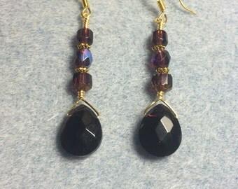 Dark purple briolette dangle earrings adorned with purple Czech glass beads.