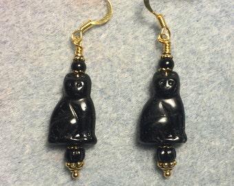 Shiny black Czech glass cat bead dangle earrings adorned with black Czech glass beads.