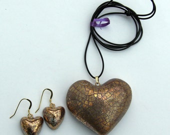 Large gold heart pendant with heart earrings.
