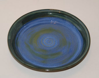 Pottery plate. Pottery dish.