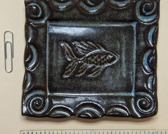 Small pottery plate by artist McMahan