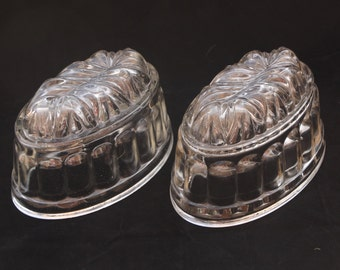 "Two matching vintage pressed glass jelly moulds 6.5"" (1 pint)"