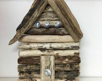 Driftwood beach hut wall hung