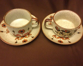 Vintage (1970's) soup mugs with matching saucers speckled background with boho flowers