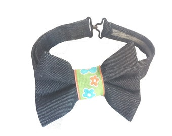 Daisy-Daisy Bowtie! Dark Denim Bow and adjustable Neck Strap with Blue & orange daisies blooming on green ribbon