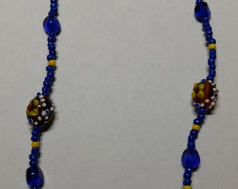 Blue beaded necklace with glass flower beads