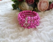 Statement spiral bracelet with Bali beads pink