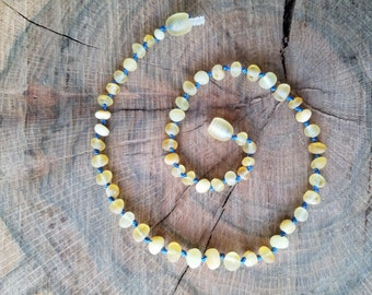 13in Raw Baltic Amber Teething Necklace on blue