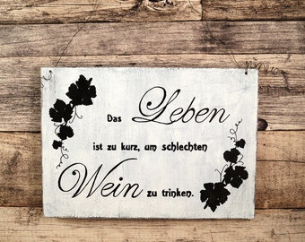 Wooden sign hand-painted slogan wine