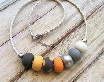 Orange and grey necklace, polymer clay necklace, beaded necklace, handmade necklace by rubybluejewels