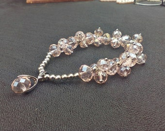 Pink crystal bracelet with silver beads (stretchy)