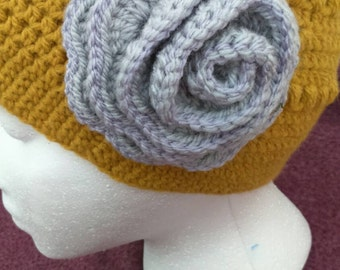 Ladies crochet hat/beanie with flower on side.