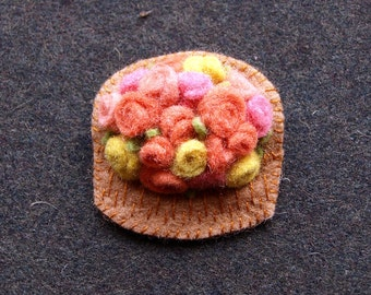 Wool felt brooch.