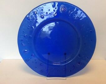Vintage large 13.5 in cobalt blue glass platter with gold stars, moon, sun motif on edge. Cobalt blue glass party platter.