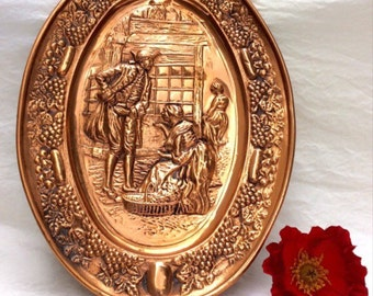 Handcrafted solid embossed copper Colonial wall plaque.