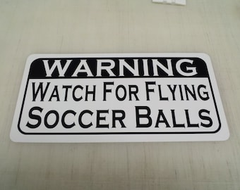 Watch for Flying SOCCER BALLS... Metal sign for Home & Kitchen Decor