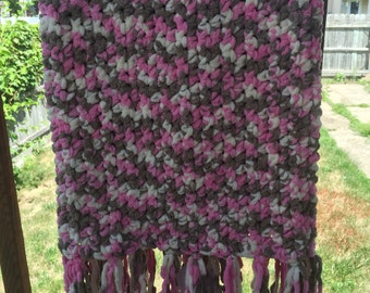 Small brown, pink, and white baby blanket