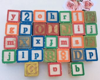 Set of 31 Vintage alphabet building blocks in primary colours.