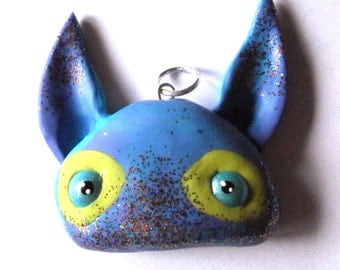 Pendant: Northern nightshade yellow eye circeled cat head