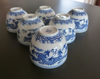 Six fine porcelain Chinese Dragon Tea bowls or cups. Chinese drinking bowls.