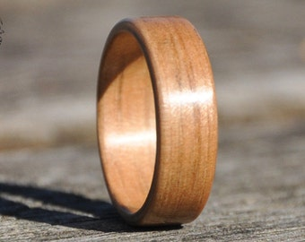 Wooden ring hand made of spotted gum. Suitable for men and women. Perfect gift, natural ring, wooden wedding band