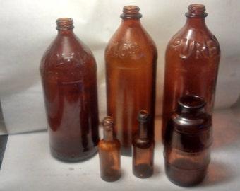 Vintage brown glass bottles  A122