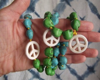 Peace out! Howlite Resin peace sign and skull meditation mala hand knotted on yellow cording