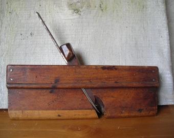 Old wooden plane.   Vintage French carpenter's moulding plane.