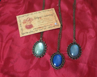 Bronze medallion + glass cabochon necklace
