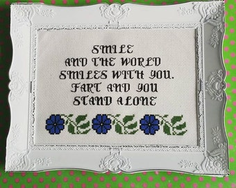 Smile and the world smiles with you. Fart and... Finished and framed cross stitch