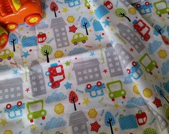 City Life, car and buildings on white woven cotton. By the 1 yard . Quality 100% Cotton Fabric.