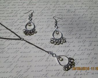 Silver and antiqued earring and neclace