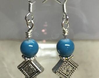 Earrings Beautiful turquoise and silvertone bead earrings.