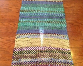 Handwoven yoga mat made from repurposed fabrics.