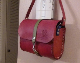 100% Leather crossbody bag with adjustable buckled straps
