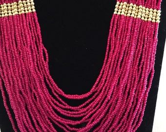 Pink multi stranded beaded necklace