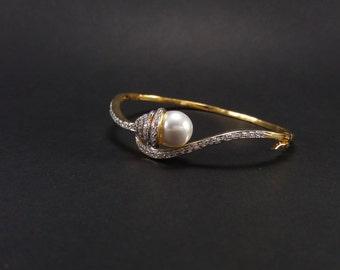 Bracelet,bollywood jewelry,pearl bracelet,diamond studded bracelet,golden bracelet,