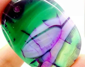 Green and purple agate geode pendant.