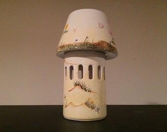 Quaint ceramic candle holder with shade lamp