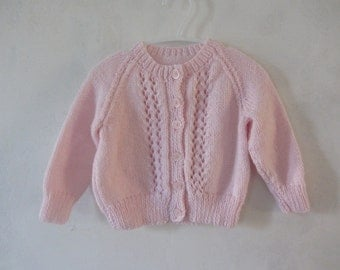 Knitted baby cardigan sweater in pink