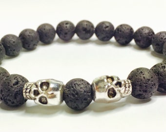 Lava rock beaded bracelet with skulls