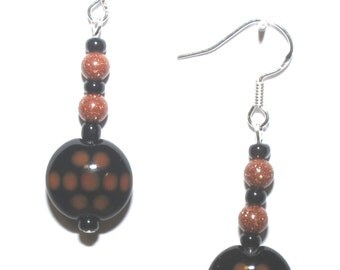 Spotted, brown and black, lampworked glass and goldstone earrings
