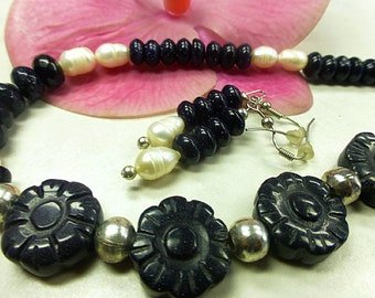 Charming Blue River set with carved beads