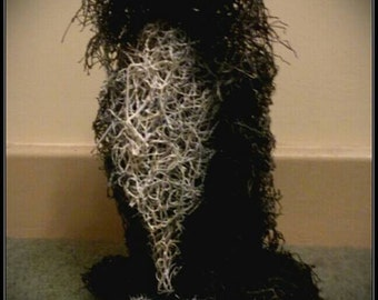 Handmade life size wire cat sculpture.