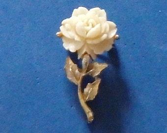 Celluloid carved rose on gold tone stem w/leave,- rose is prong set. vintage 1950's-1960's