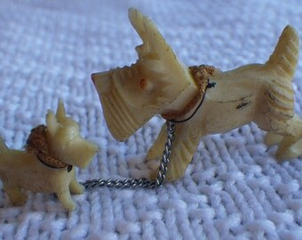 Celluloid Scottie dog and pup